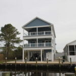 Teal Bliss Waterfront newly constructed home in Swann Keys exterior waterfront