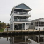 Teal Bliss Waterfront newly constructed home in Swann Keys exterior