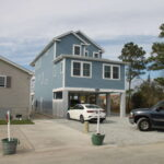 Teal Bliss Waterfront newly constructed home in Swann Keys driveway side