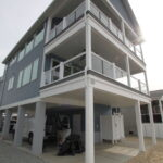 Teal Bliss Waterfront newly constructed home in Swann Keys exterior close up of waterfront porches