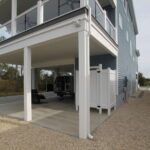 Teal Bliss Waterfront newly constructed home in Swann Keys carport and storage areas