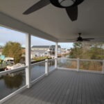 Teal Bliss Waterfront newly constructed home in Swann Keys view from second story porch