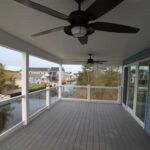 Teal Bliss Waterfront newly constructed home in Swann Keys second floor porch