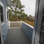 Teal Bliss Waterfront newly constructed home in Swann Keys side porch
